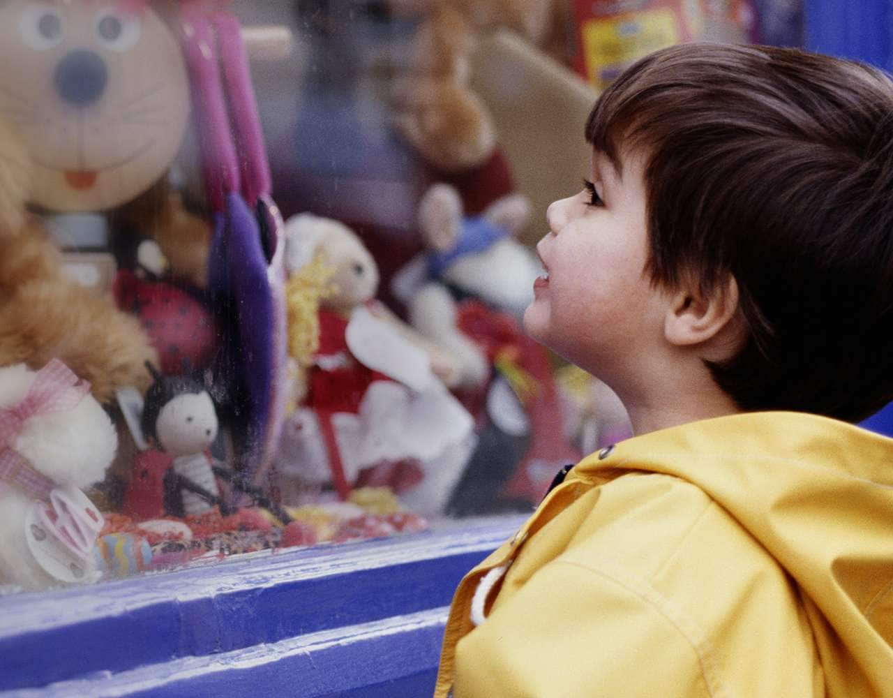Kid looking at toys