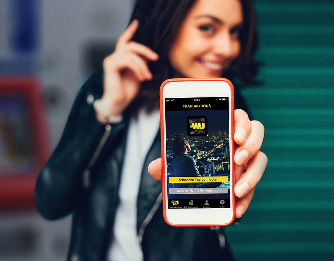 Girl showing WU mobile app