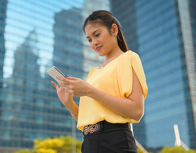 lady with her phone in the business centre