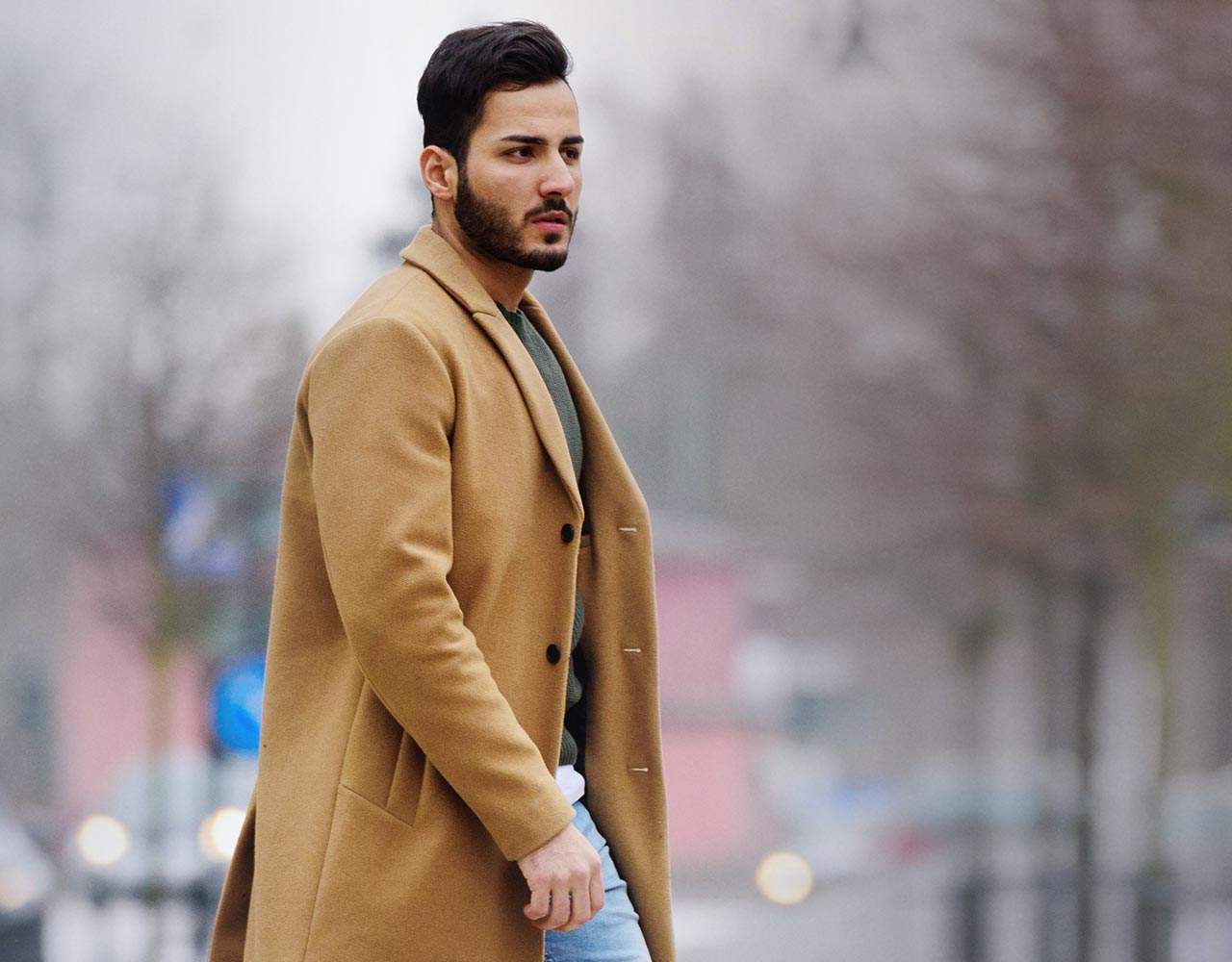 Man in a coat walking in the street