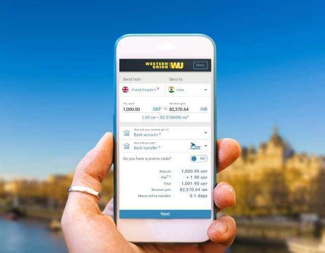 Hand holding smartphone with Western Union app