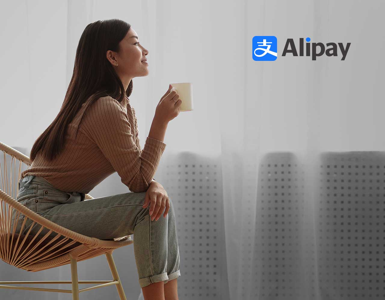 Girl with a cup and AliPay logo in right corner