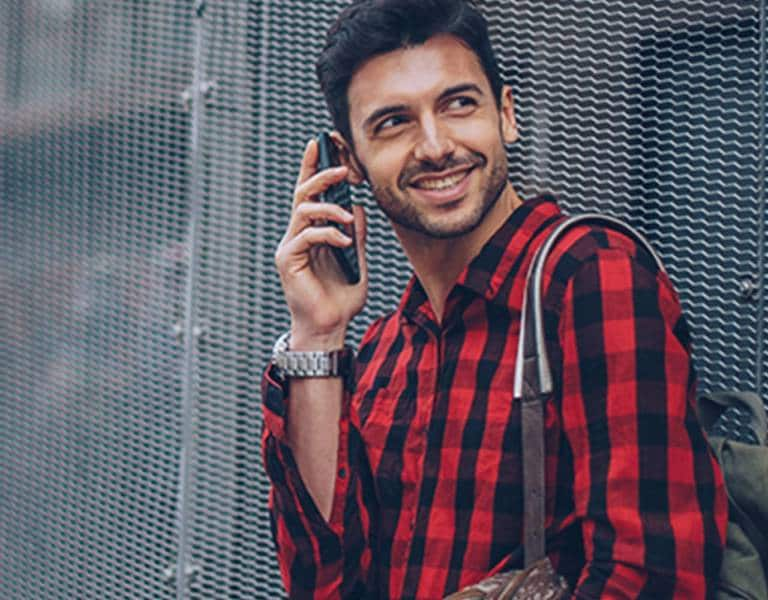 Man holding smartphone with Western Union app